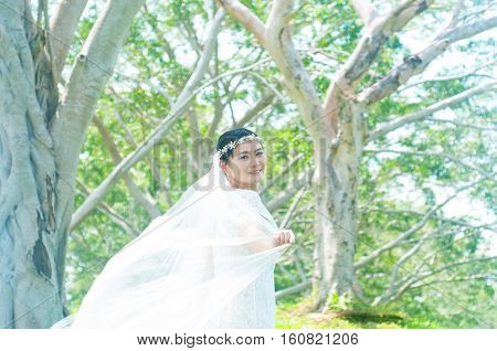 Outdoor portrait of a beautiful asian bride