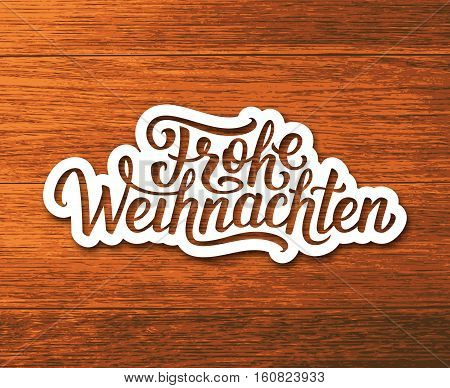 Frohe Weihnachten deutsch text on white paper label with hand lettering over wooden background. Merry Christmas sticker or greeting card vector design template with german inscription