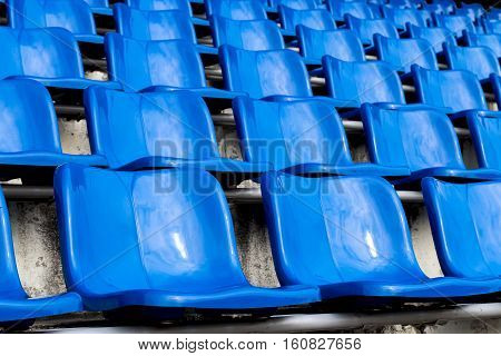 Blue seats on the stadium. Seats for watching some sport or football.