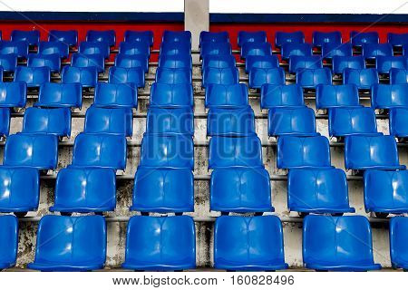 Blue seats on the stadium. Seat for watch some sport or football.