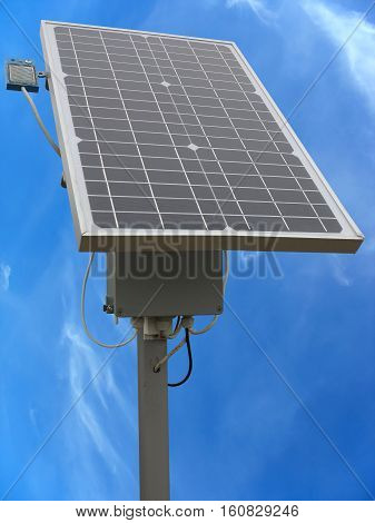 Solar Panel With The Equipment Rack And Cables Over Blue Sky
