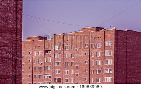 View of the newly built residential area. Vintage effect. Apartment buildings. Municipal housing. Cheap accomodation. High-rise buildings