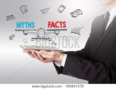 Myths vs facts Balance, young man holding a tablet computer