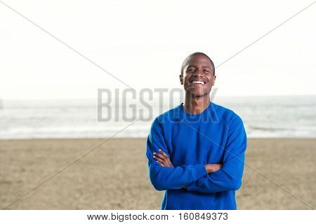 Smiling Black Man In Blue Sweatshirt At The Beach
