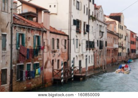 Street in Venice Italy. Venice city famous channel blurred image. Venice street river view. Wet buildings by the channel vintage picture. Italy travel photo. Historical part of Venice image in blur