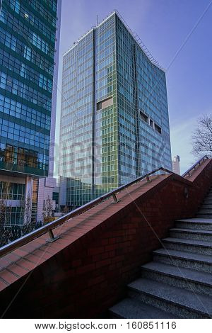 Stone staircase and modern office buildings in the city center to Poznan