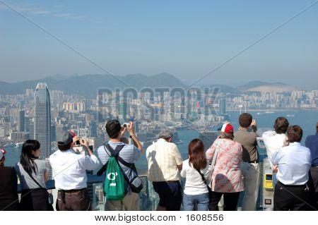 Tourists Sightseeing The Hong Kong Skyline