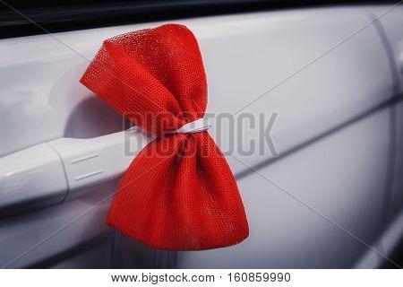 Wedding decoration on wedding car, beautiful red bow