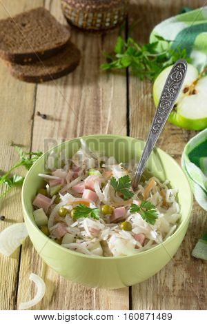 Salad With Sauerkraut, Ham, Apple And Green Peas. Snack On A Festive Table. Healthy Food Concept.