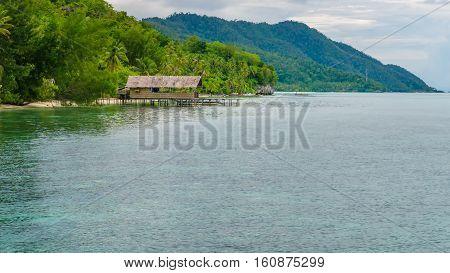 Homestay on Kri Island, Monsuar in Background, Raja Ampat, Indonesia. West Papua