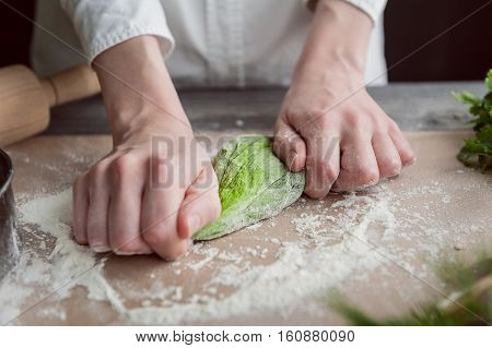 Woman Kneads Dough For Ravioli
