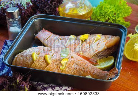 raw sea bass in a pan ready for baking
