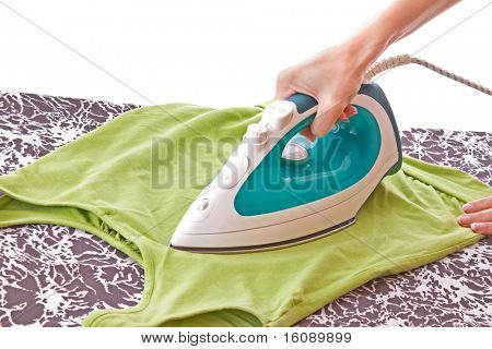 A woman ironing a t-shirt