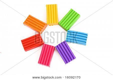 Children bright multicoloured plasticine  isolated on white