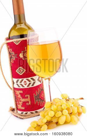 Wine and grapes isolated on white background.