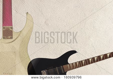Black electric rock guitar and grey back of guitar body on the light skin background with plenty of copy space.