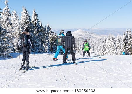 Kopaonik, Serbia - January 19, 2016: Ski resort Kopaonik, Serbia, ski slope, people skiing and snowbarding down the hill, mountains view