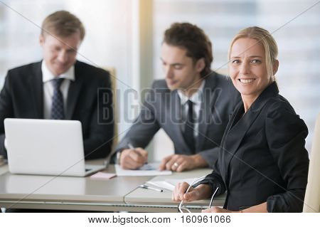 Group of businessmen working, women in business, empowering female entrepreneur, creating dream career, writing together convincing business plan as a first step in starting up a profitable business