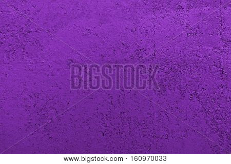 Stucco purple wall background or texture.Plaster, plaster texture, plaster background. Purple wall, purple background.Color plaster. Concrete, concrete background.