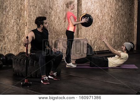 Sport Fitness Man Doing Abdominal Crunches Crossfit Training, Young Healthy People Group Gym Interior