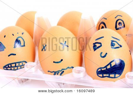 Group of brown hen's eggs with different faces in the box
