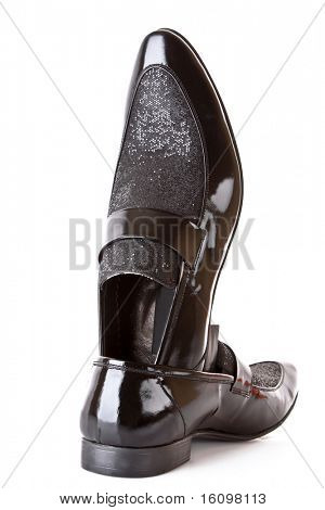 Black shiny man's shoe isolated on white