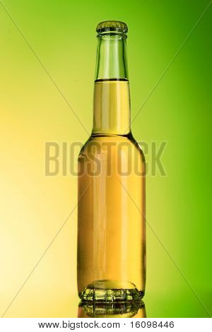 Bottle with alcohol on green background