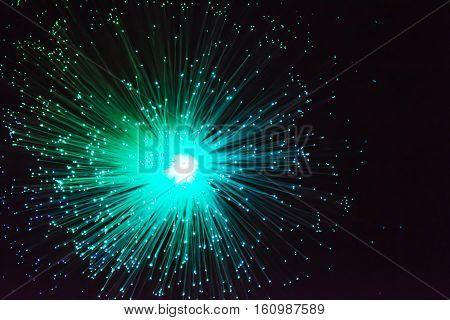 Green flash or firework on dark background
