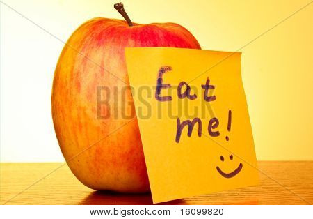 An apple on yellow background with