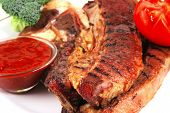 grill steak with spicy sauces and vegetables poster