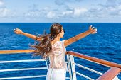 Cruise ship vacation woman enjoying travel vacation at sea. Free carefree happy girl looking at ocea poster
