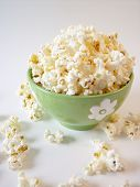 stock photo of matinee  - popcorn in a green bowl - JPG