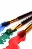 stock photo of paint brush  - paint brushes in color paint - JPG