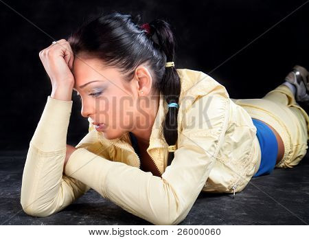 Portrait of attractive young woman with headache, studio slhot