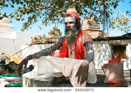 ORCHHA, INDIA -17 FEBRUARY: Spiritual Guru Shaiva sadhu (holy man) sits under the tree in front of  Ram Raj Temple, February 17, 2008. Orchha, Madhya Pradesh, India