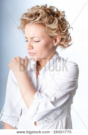 Woman with pain in her shoulder, Isolated medical shot over white background
