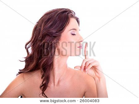 Young woman giving the shhh.be quit sign