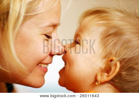 Family moments - Mother and child have a fun, soft focus