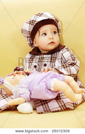 Cute baby with doll
