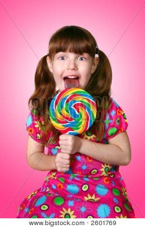 Bright Pink Image Of A Girl Licking A Lollipop