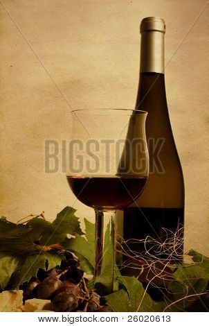 Cup and bottle of wine with grapes