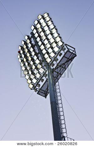 Stadium lights and blue sky