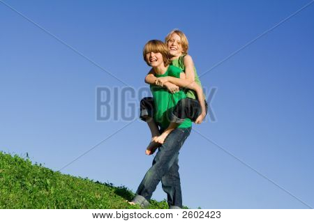Children Playing Piggyback