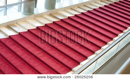 Stairs covered with red carpet