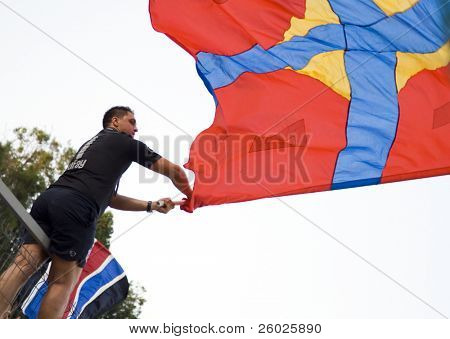 BUCHAREST, ROMANIA - JULY 16: Supporter with flag at a European League qualification match between Steaua Bucuresti and Ujpest Budapest on july 16, 2009, Bucharest, Romania.