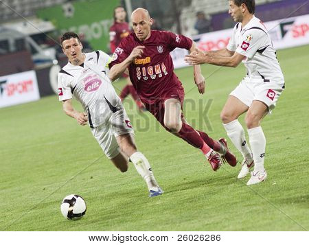 CLUJ-NAPOCA, ROMANIA - APRIL 24: Muresan in action at a Romanian National Championship soccer game CFR Cluj vs. Unirea Alba Iulia, April 24, 2010 in Cluj-Napoca, Romania.