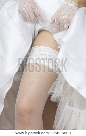 Bride shoving her stockings