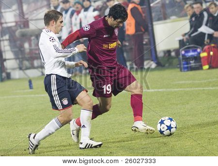 CLUJ-NAPOCA, ROMANIA - NOVEMBER 3: Philipp Lahm(L) and Juan Culio (R) in the UEFA Champions League match between CFR 1907 Cluj and FC Bayern Munchen - Cluj-Napoca, Romania on November 3, 2010