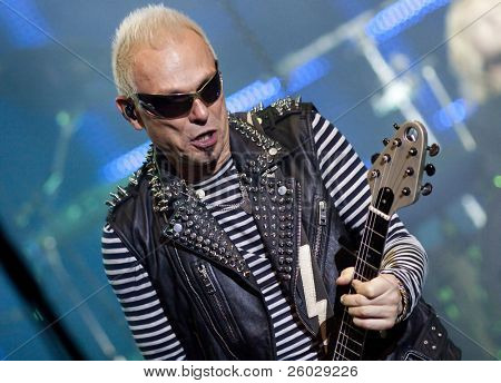 CLUJ NAPOCA, ROMANIA – OCTOBER 8: Rudolf Schenker from Scorpions rock band performing at Cluj Arena Grand Opening concert on October 8th, 2011 in Cluj-Napoca, Romania