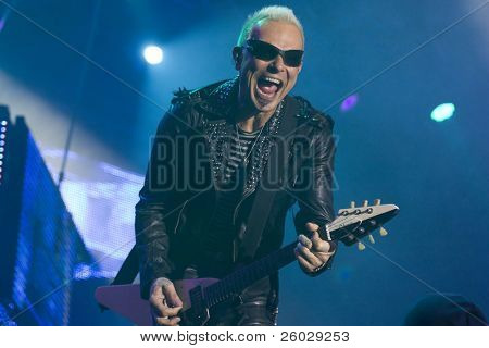 CLUJ NAPOCA, ROMANIA – OCTOBER 8: Rudolf Schenker from Scorpions rock band performs at Cluj Arena Grand Opening concert on October 8, 2011 in Cluj-Napoca, Romania